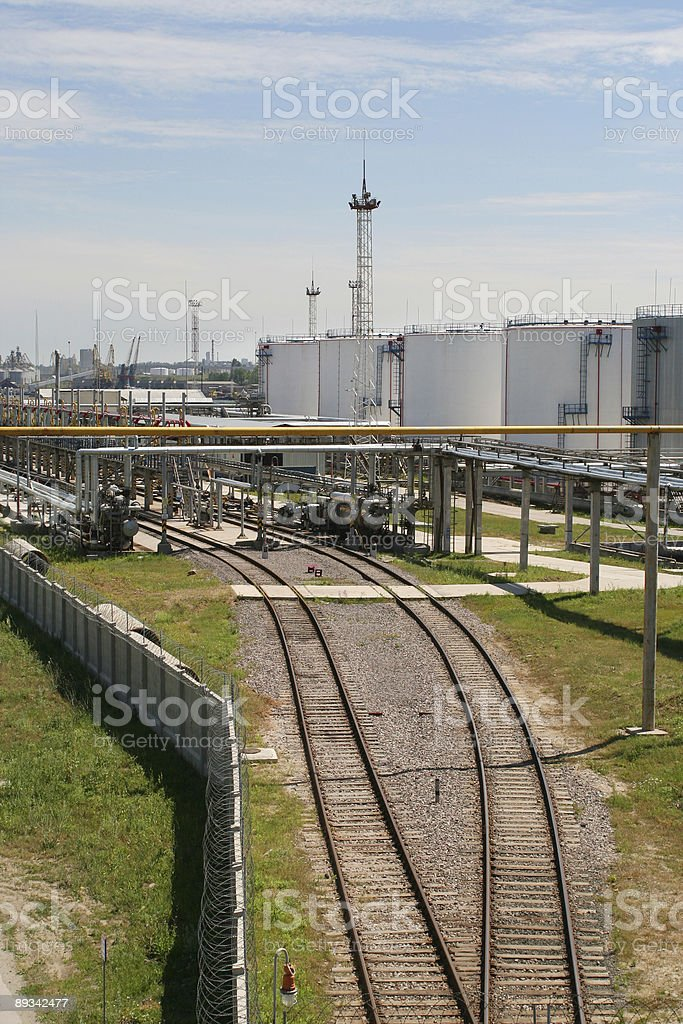 Railroad to tanks in oil harbor royalty-free stock photo