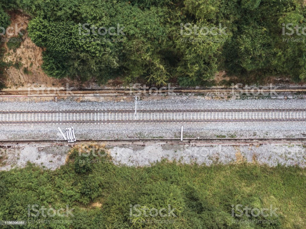 Railroad track in a rural area as seen from directly above