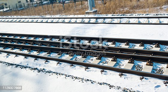 Railroad track covering with snow.