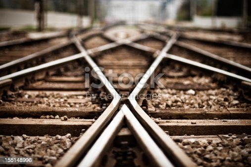 Railroad  track points background. Shallow DOF, selective focus. Toned image.