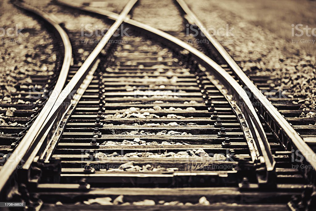 Railroad track points background. Shallow DOF, selective focus. Toned...