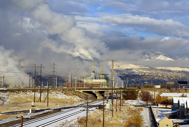 railroad track to city oil refinery - mikefahl stock pictures, royalty-free photos & images