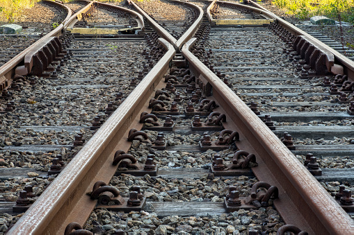 Railroad track with a switch to change lane in full perspective focus