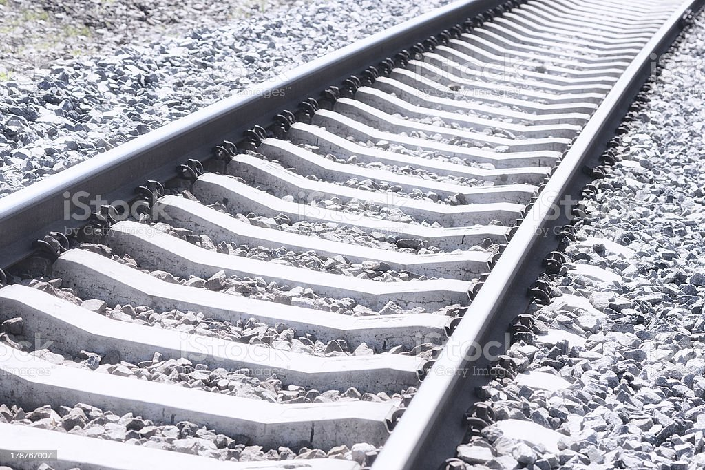 Railroad tracks and a mound of stones royalty-free stock photo