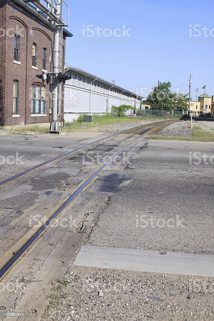 Railroad Tracks and Old Buildings stock photo