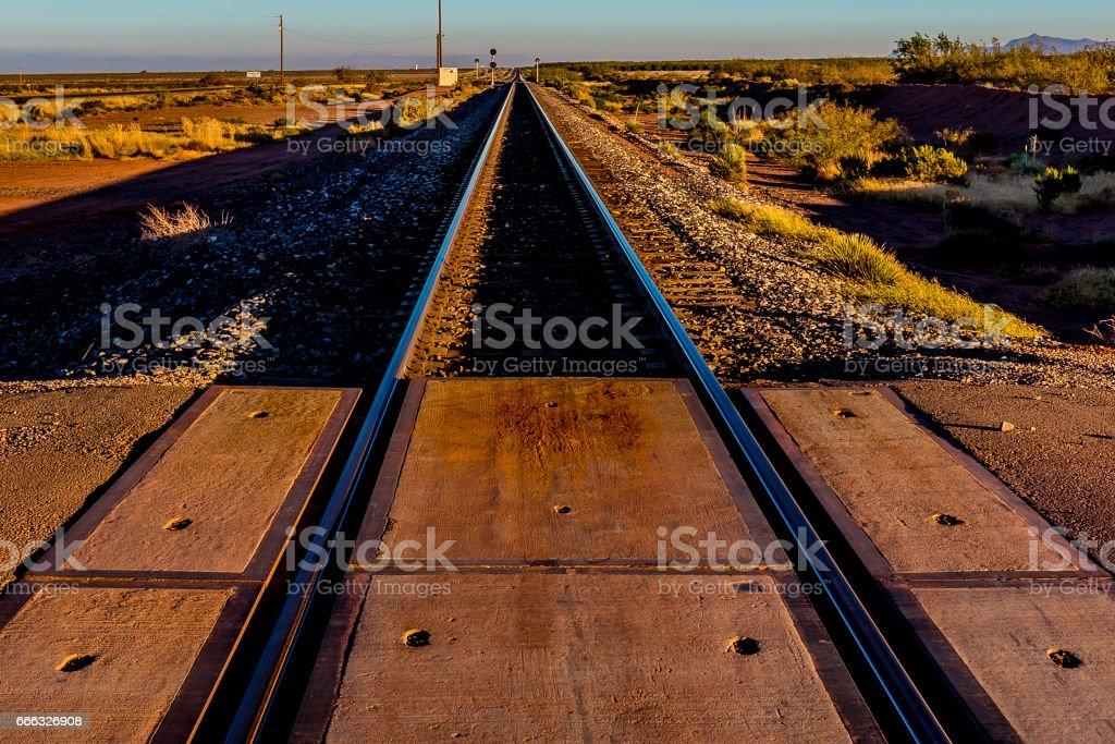 Railroad Tracks Heading North into New Mexico Desert. stock photo
