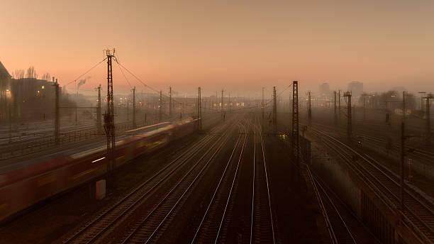 railroad tracks in foggy munich at sunset - munich train station bildbanksfoton och bilder