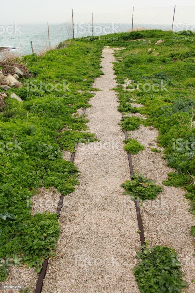 Railroad tracks in the complex of the temple in Byblos stock photo