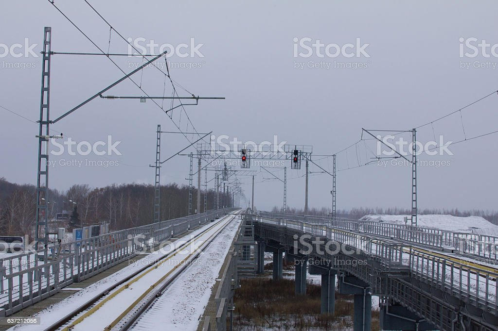 railroad tracks of airport train at cloudy day stock photo
