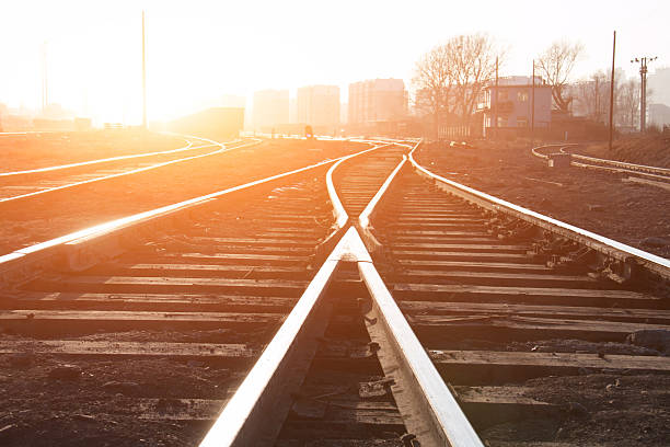 Railroad tracks Railroad tracks at sunset tramway stock pictures, royalty-free photos & images