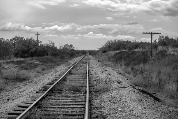 railroad tracks with sky Texas monochrome stock photo