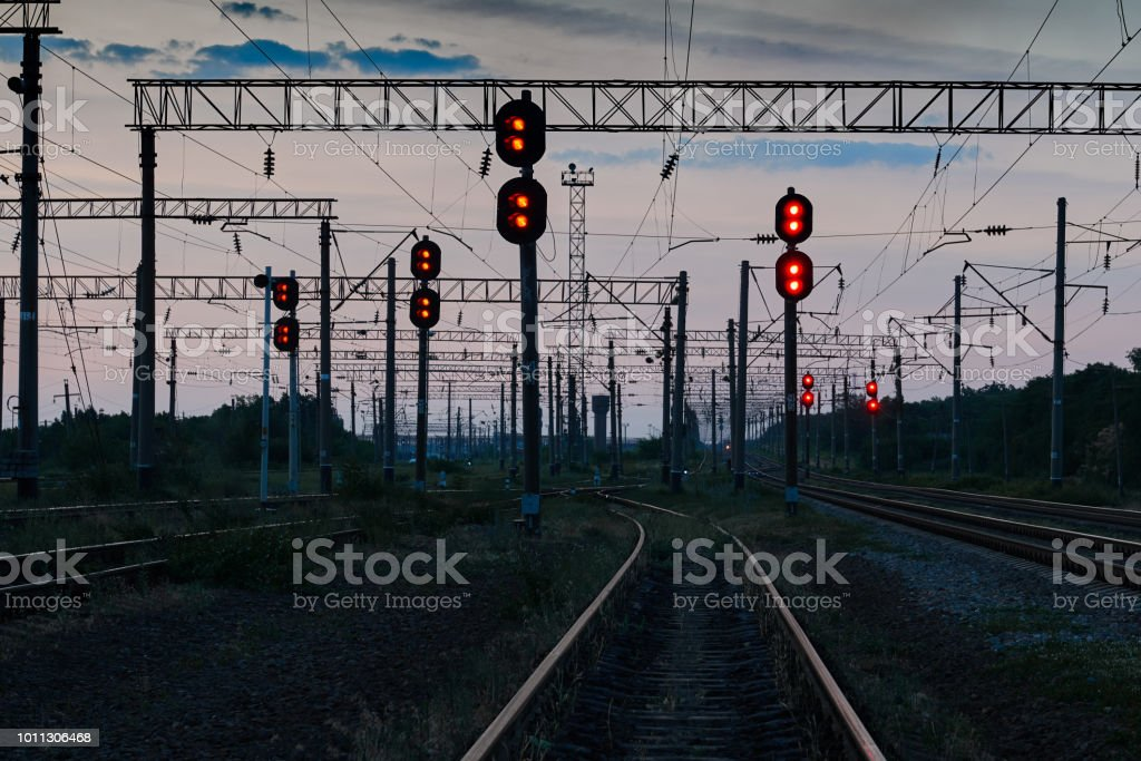 railroad traffic lights and infrastructure during beautiful sunset, colorful sky, transportation and industrial concept stock photo
