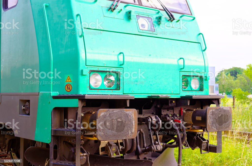 Railroad train railway tracks in the countryside with trackbed ballast and switch at a railroad crossing stock photo
