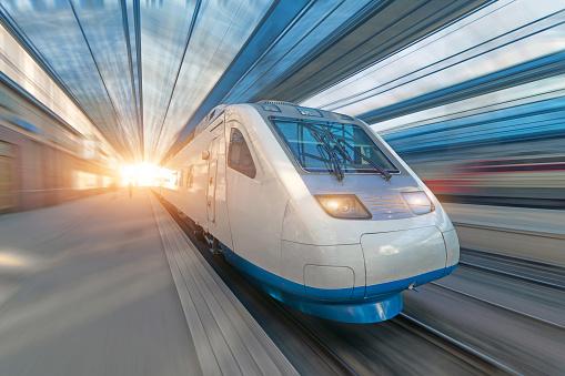 Railroad travel passenger train with motion blur effect, concept tourism