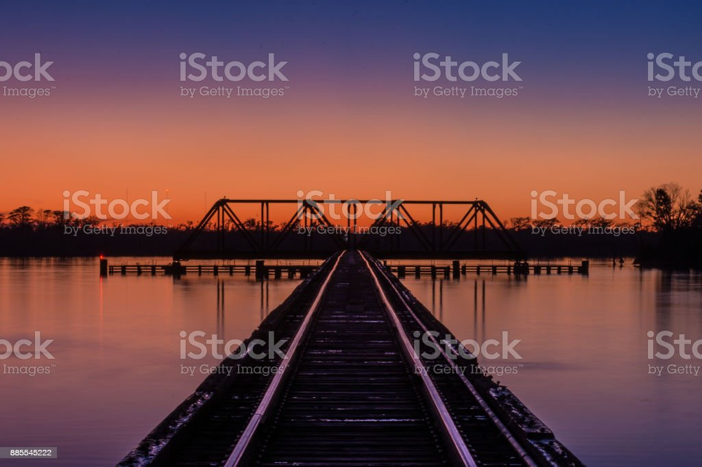 Railroad Trestle and Bridge After Sunset stock photo