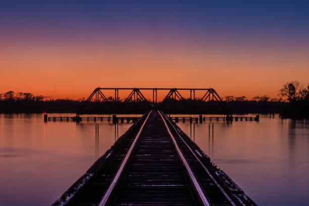 Railroad Trestle and Bridge After Sunset stock photo