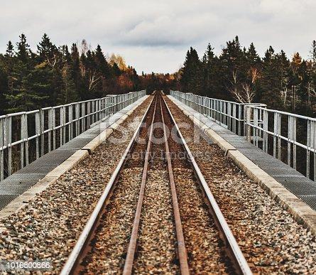 Looking down railroad tracks crossing a trestle bridge.