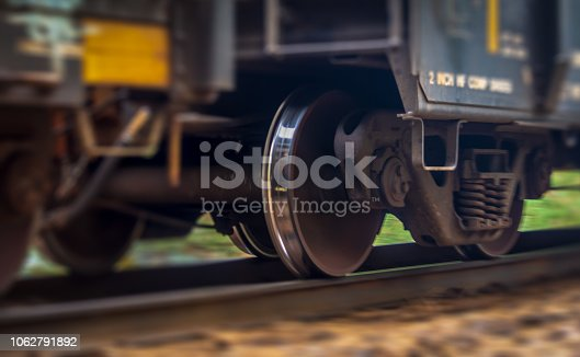 A close up view of a trains wheel in motion as it speeds past