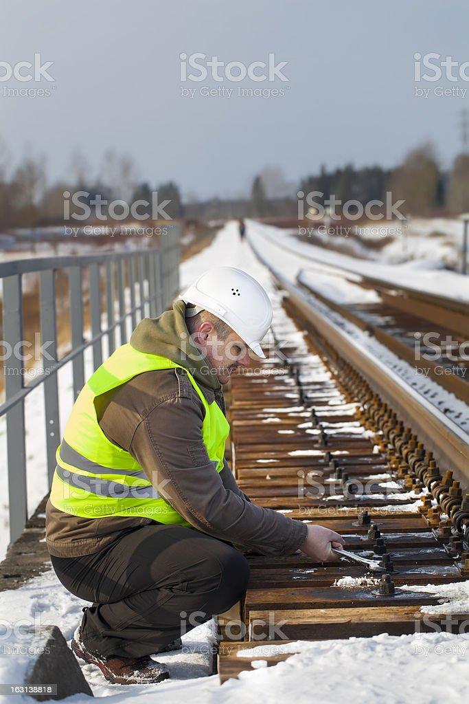 Railroad worker on the railway bridge royalty-free stock photo