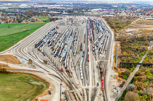 Aerial view of a large rail yard located just outside of St. Louis, Missouri on the eastern side of the Missisppi River in the state of Illinois.