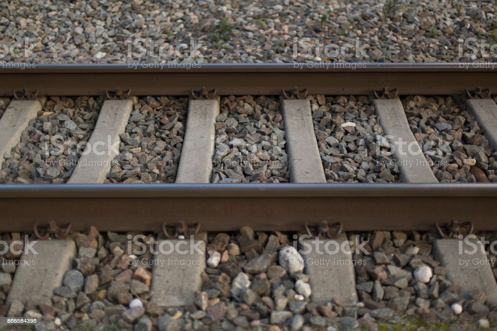 Rails and crushed stone closeup background royalty-free stock photo