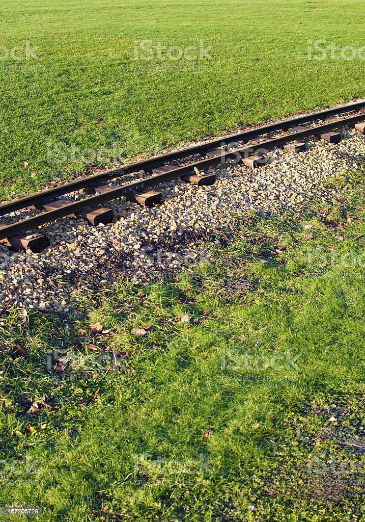 railtracks in a meadow stock photo