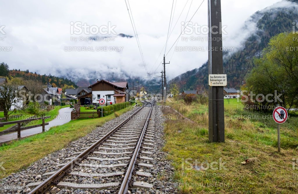 Railway across middle of Obertraun town. The weather was so cloudy and ready to rain any times. stock photo
