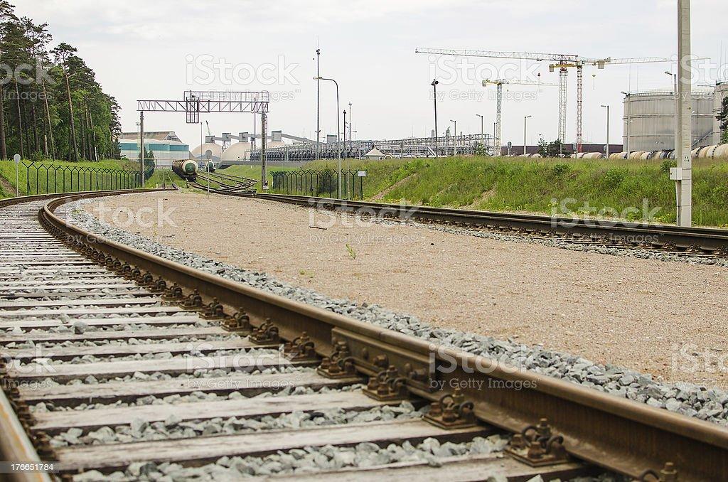 Railway and factory next to Klaipeda, Lithuania royalty-free stock photo