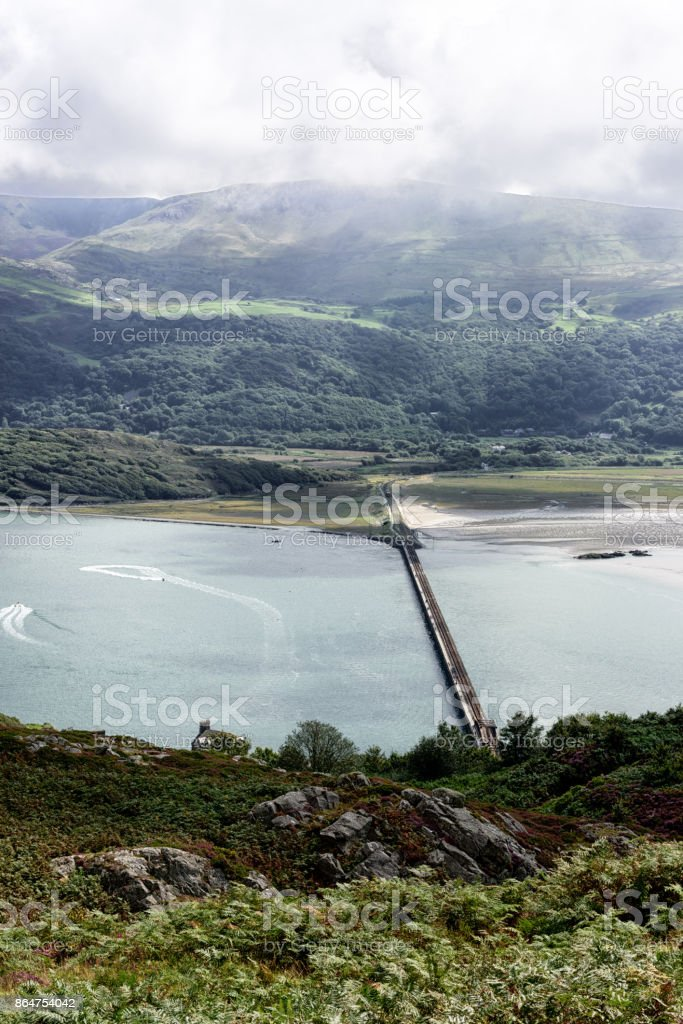 Railway bridge across  estuary, Barmouth, Wales stock photo