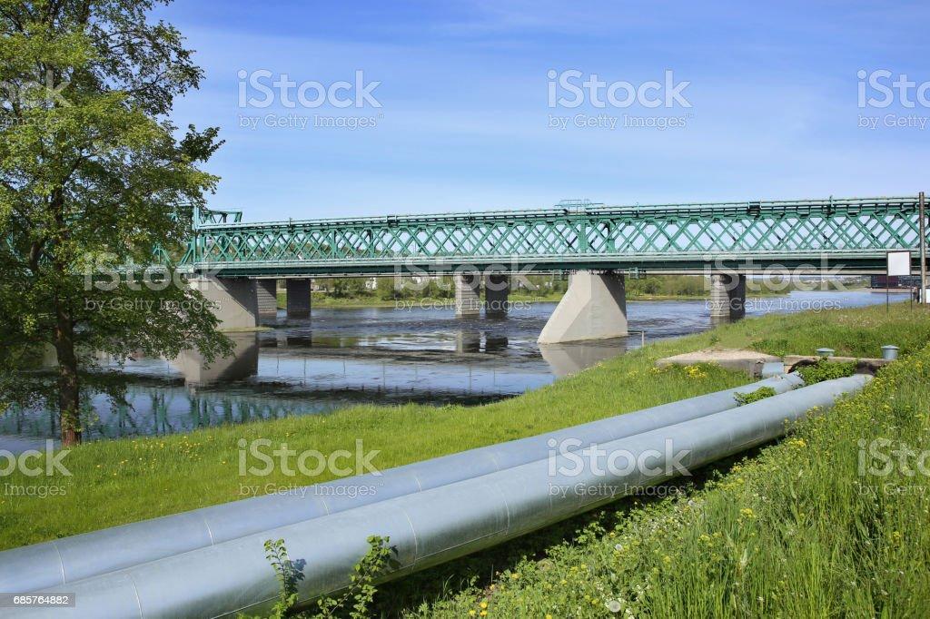 Railway bridge and industrial pipes. zbiór zdjęć royalty-free