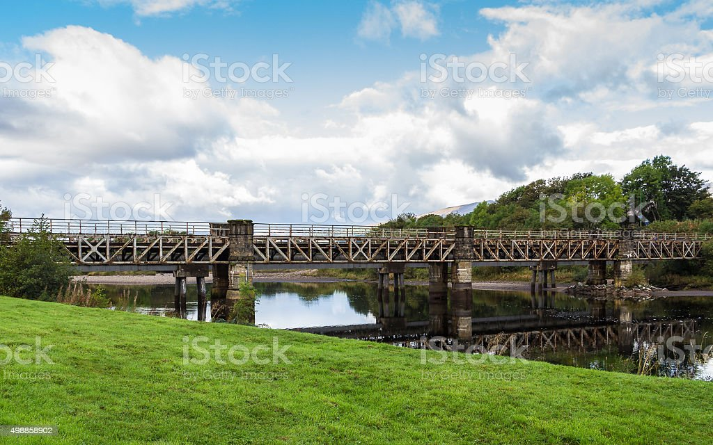 Railway bridge over river Lochy in Fort William, Scotland stock photo