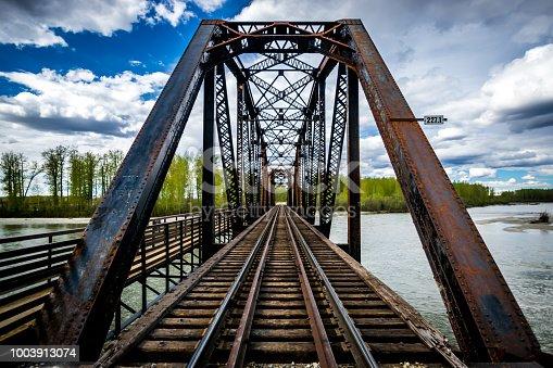 Old metal railway bridge over Talkeetna river, Alaska.