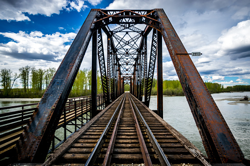 Old metal railway bridge over Talkeetna river, Alaska.