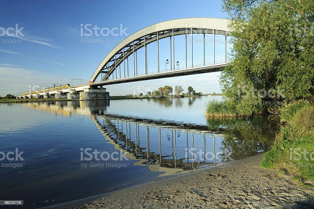 Railway bridge with approaching train royalty-free stock photo