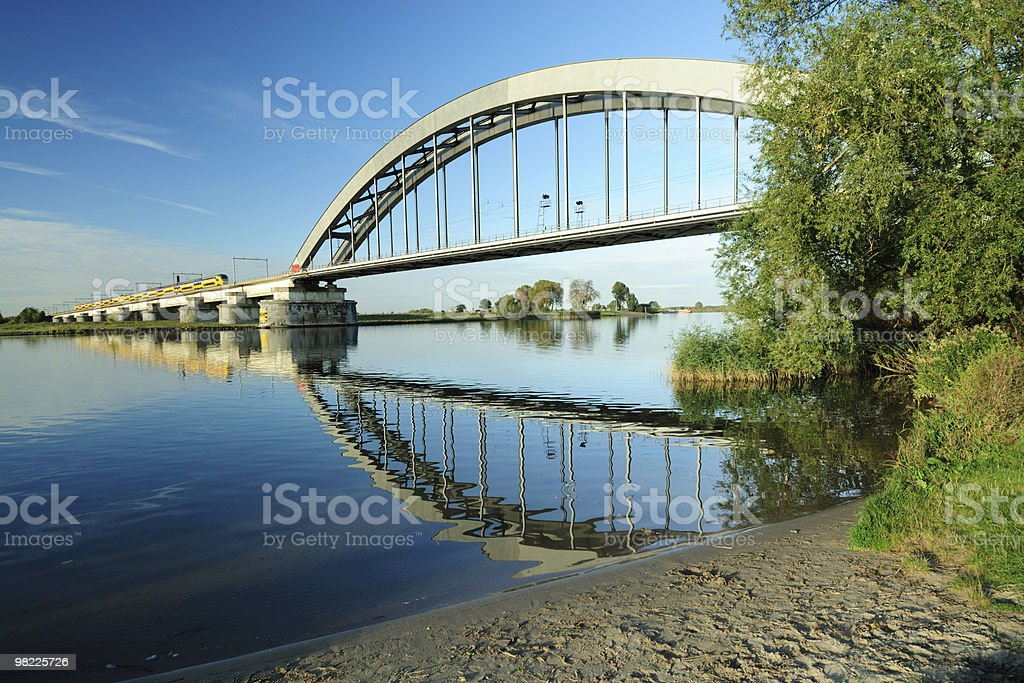 Railway bridge with approaching train stock photo