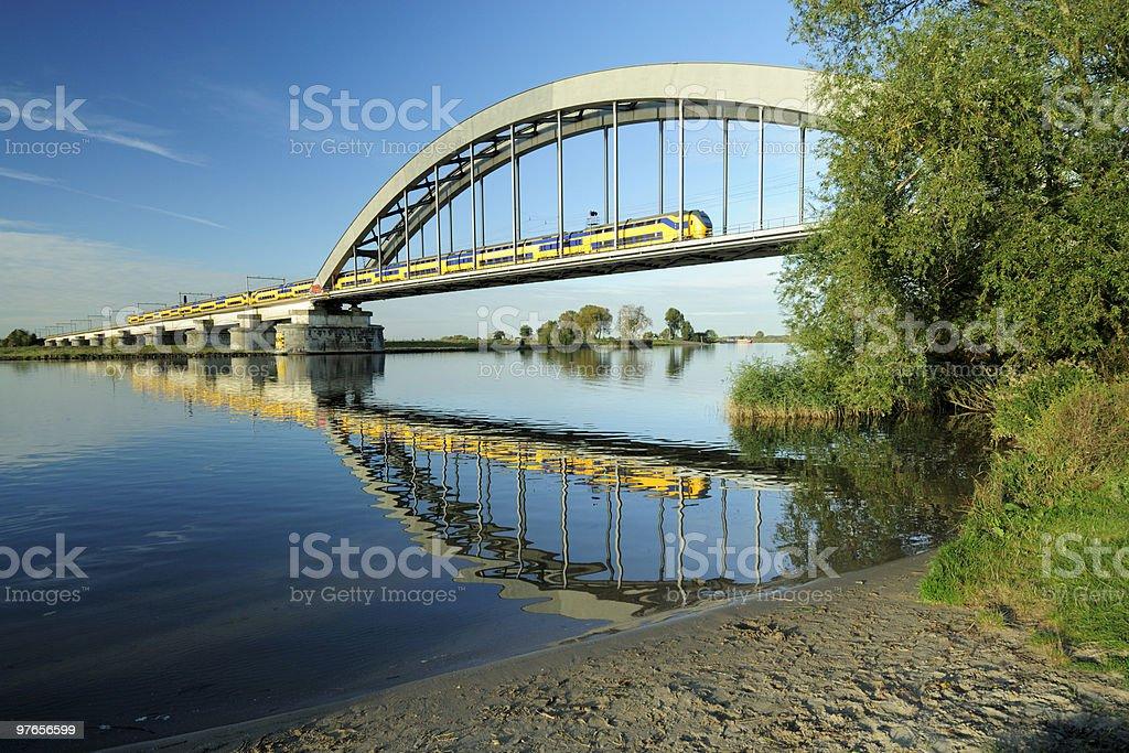 Railway bridge with train royalty-free stock photo