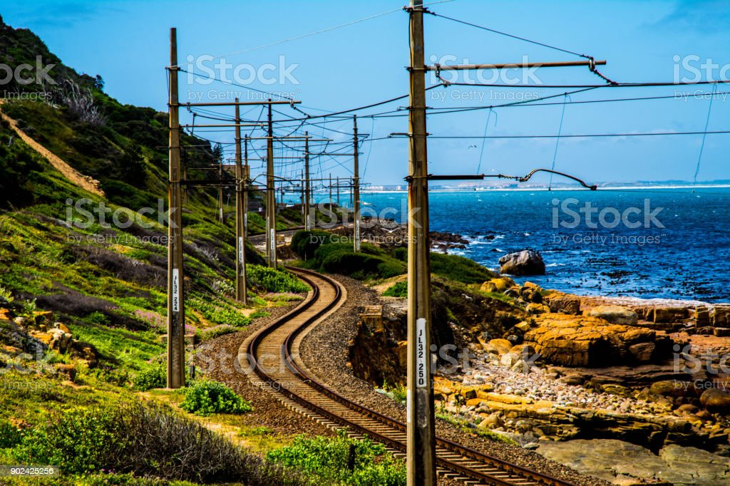 Railway by coastline in Simons Town, South Africa royalty-free stock photo