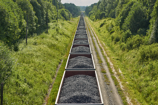Railway cargo cars carrying coal