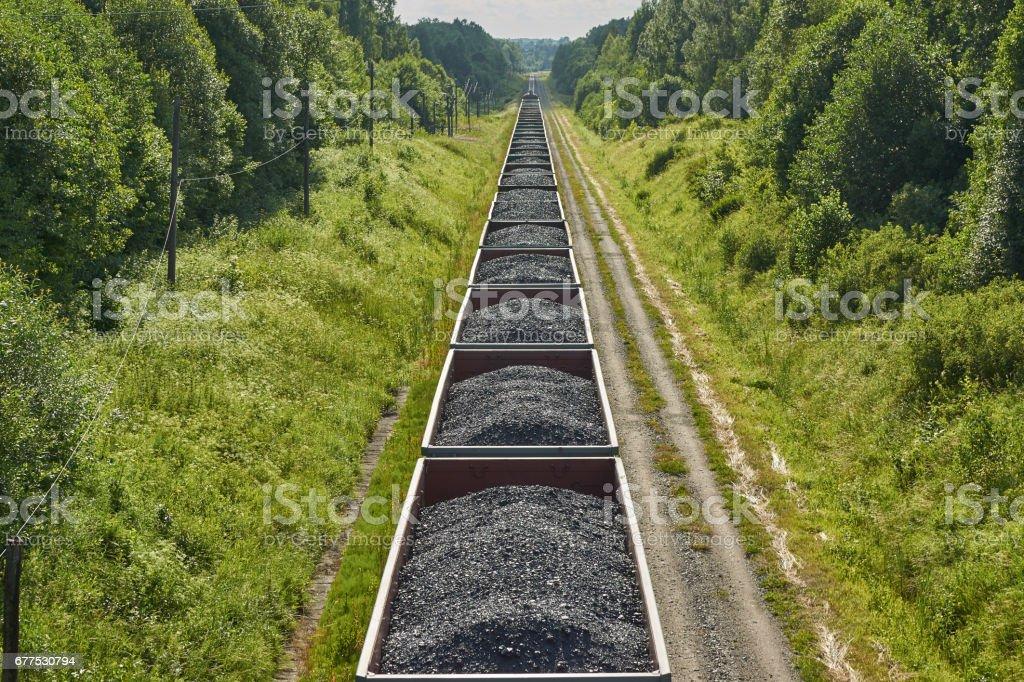 Railway cargo cars carrying coal stock photo