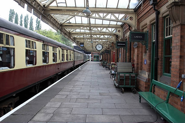 Railway carriages at empty station Railway carriages at station railroad station platform stock pictures, royalty-free photos & images