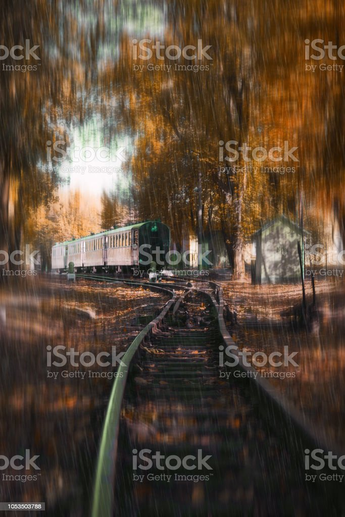 Railway cars at the station. Autumn rainy weather. Autumn background. Seasons. stock photo