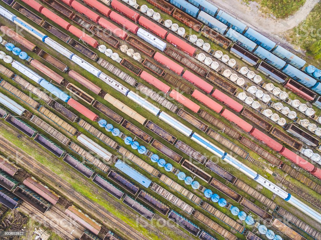 Railway cars lined up in ranks. Colorful wagons seen from the bird's eye view. stock photo