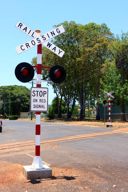 Railway Crossing Sign on a country road stock photo