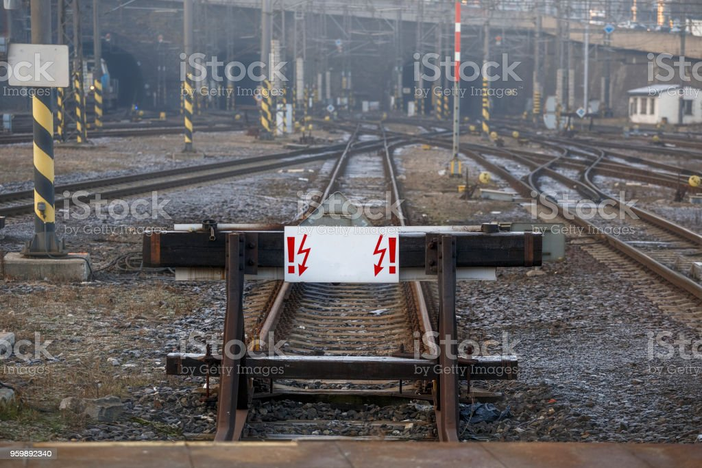 Railway deadlock with a white sign. Concept: travel is prohibited, end of the road stock photo