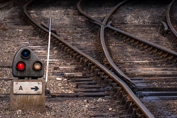 railway junction point - railway signal stock photos and pictures
