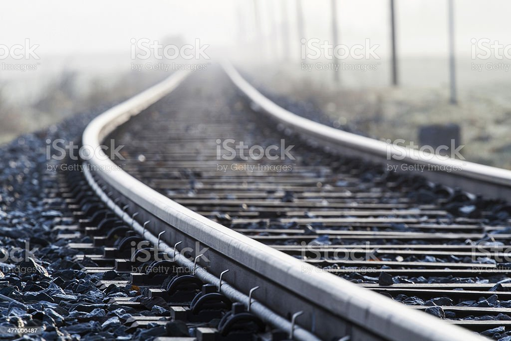 Railway line in morning fog in rural Bavaria, Germany stock photo