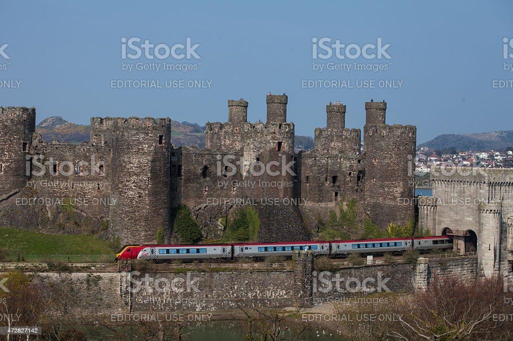 railway line runs along the base of the medeval castle stock photo