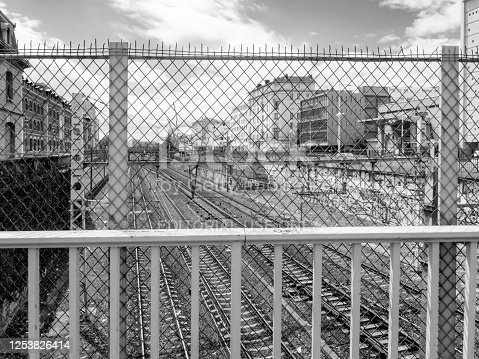 Railway lines entering a rail station in Lyon, France. There is some graffiti along the embankments.
