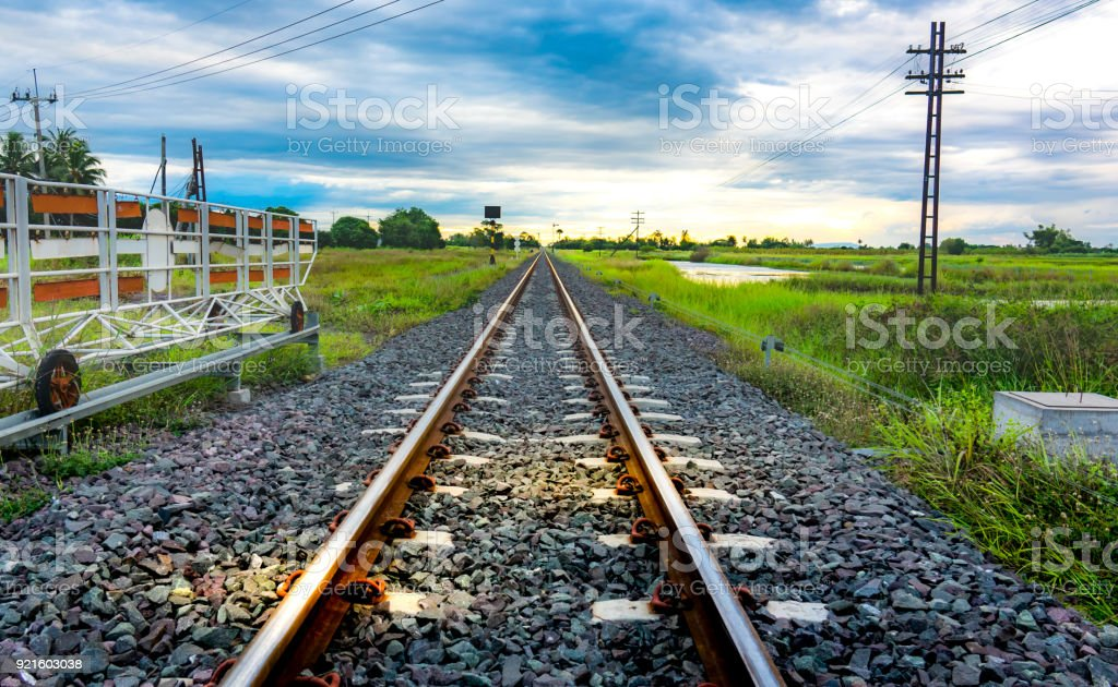 Railway of train on traffic light station on blue sky and cloud stock photo