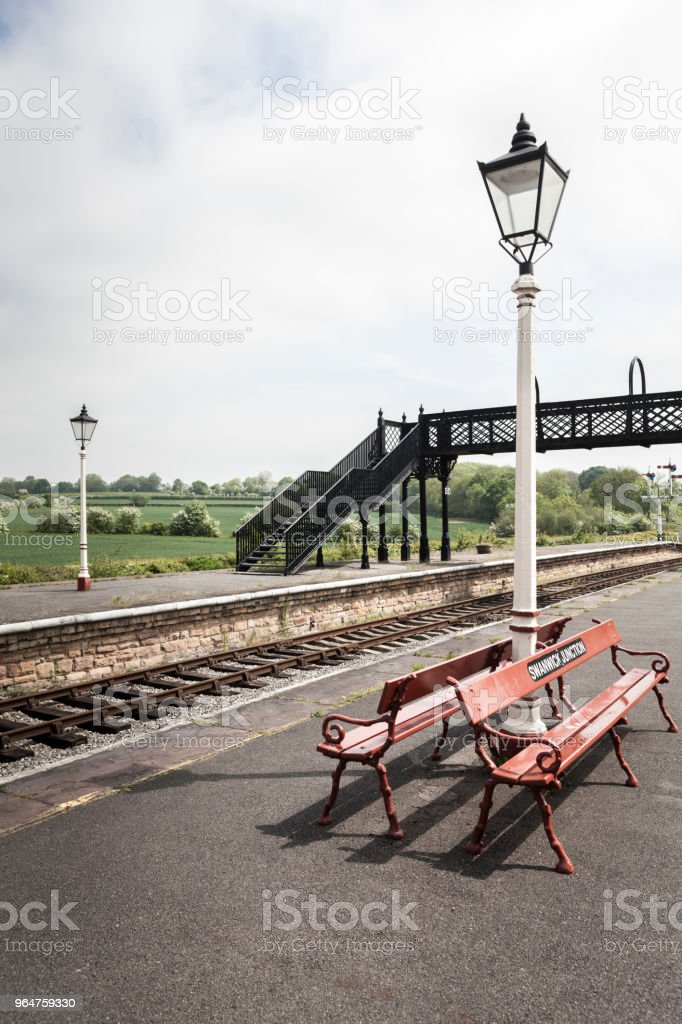 Railway platform bench and lamps royalty-free stock photo